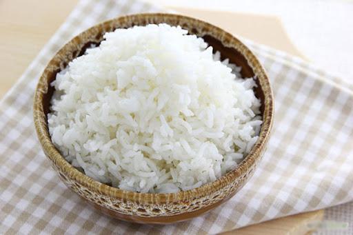 Tinh bột trong cơm giúp hạn chế việc tiết dịch axit trong dạ dày